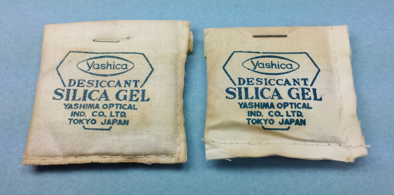 Recently discovered silica gel packs from around 1956 or so. First time I've seen the dual designation of Yashima / Yashica on something as small as these. The company was changing its name from Yashima Optical Industries Company, Limited to Yashica Company, Limited. These were part of a complete original Yashica LM set I recently added to my collection.
