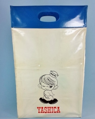 A fun little find recently. Yashica's Sailor Boy found on a vinyl shopping bag from around 1962. Looks like it was a promotional item from Yashica and features the name of the dealer on the reverse side of the bag. The bag stands about 14 inches tall and about 6 inches wide. Made from heavyweight vinyl that has stood the test of time!